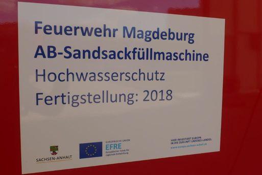 Aufkleber Fördermittel AB Sandsackfüllmaschine